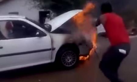 Uma aula de como NÃO apagar o fogo num carro
